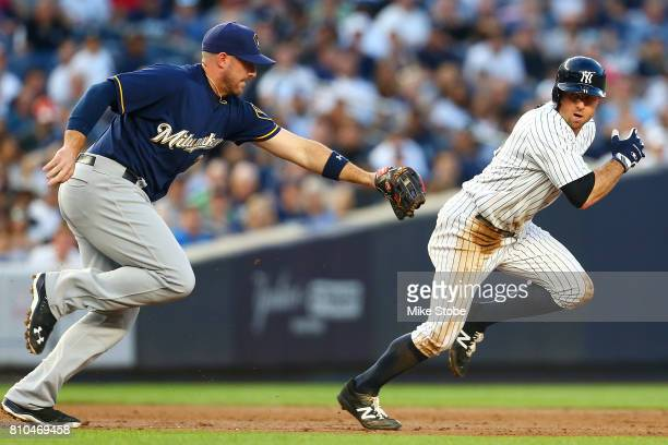 Brett Gardner of the New York Yankees is caught in a run down and tagged out by Travis Shaw of the Milwaukee Brewers at Yankee Stadium on July 7 2017...
