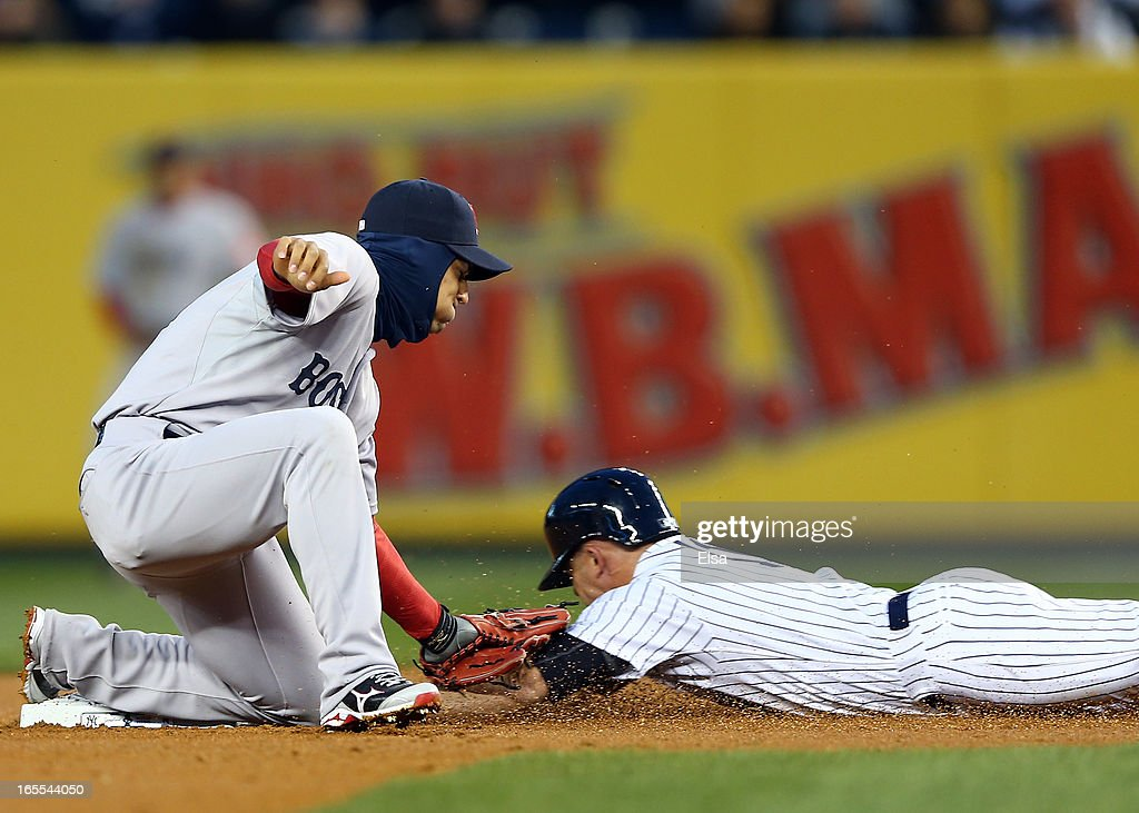Brett Gardner #11 of the New York Yankees is caught stealing in the first inning by Jose Iglesias #10 of the Boston Red Sox on April 4, 2013 at Yankee Stadium in the Bronx borough of New York City.
