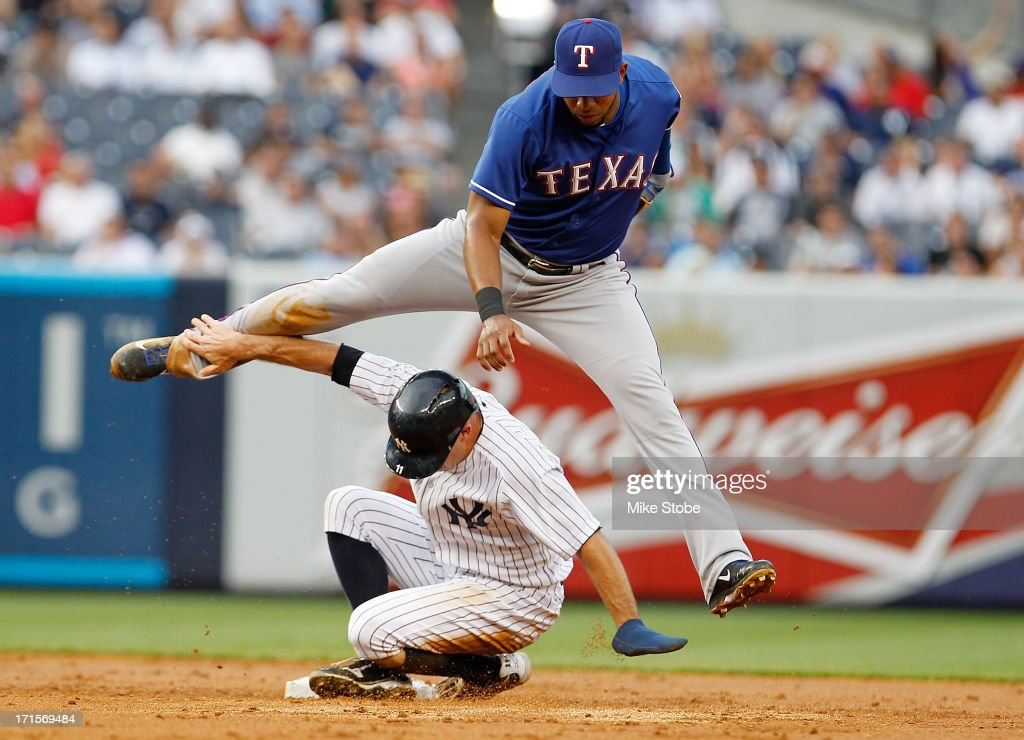 Brett Gardner #11 of the New York Yankees is forced out at second as Elvis Andrus #1 of the Texas Rangers completes the double play at Yankee Stadium on June 26, 2013 in the Bronx borough of New York City.