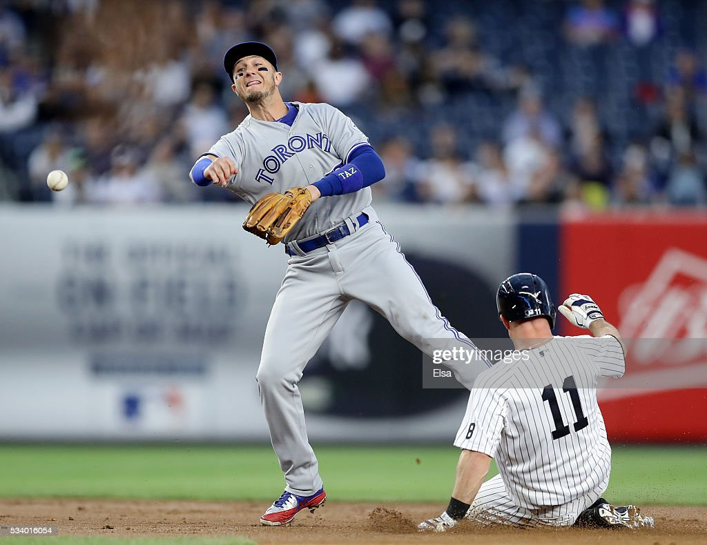 Brett Gardner #11 of the New York Yankees is out at second as Troy Tulowitzki #2 of the Toronto Blue Jays is unable to make the out at first base in the first inning at Yankee Stadium on May 24, 2016 in the Bronx borough of New York City.