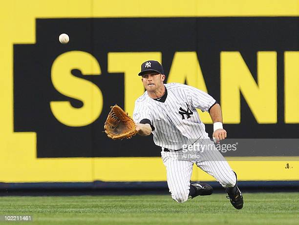 Brett Gardner of the New York Yankees makes a catch against the New York Mets on June 18 2010 at Yankee Stadium in the Bronx borough of New York City
