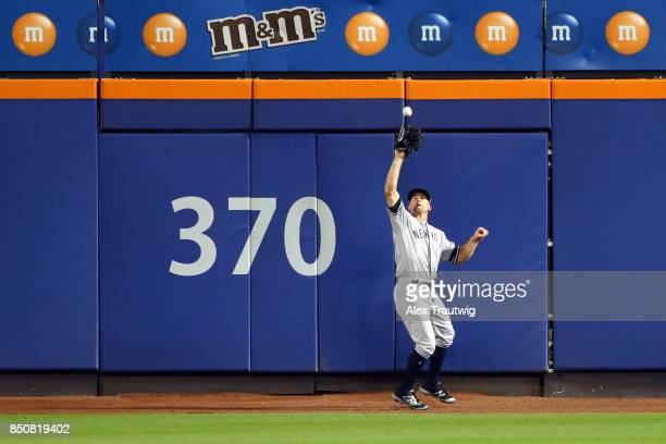 Brett Gardner of the New York Yankees makes a catch during the game against the Tampa Bay Rays at Citi Field on Monday September 11 2017 in the...