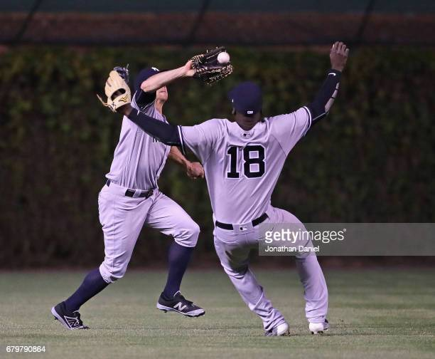 Brett Gardner of the New York Yankees makes a catch in the 6th inning against the Chicago Cubs as teammate Didi Gregorius avoids the collision at...