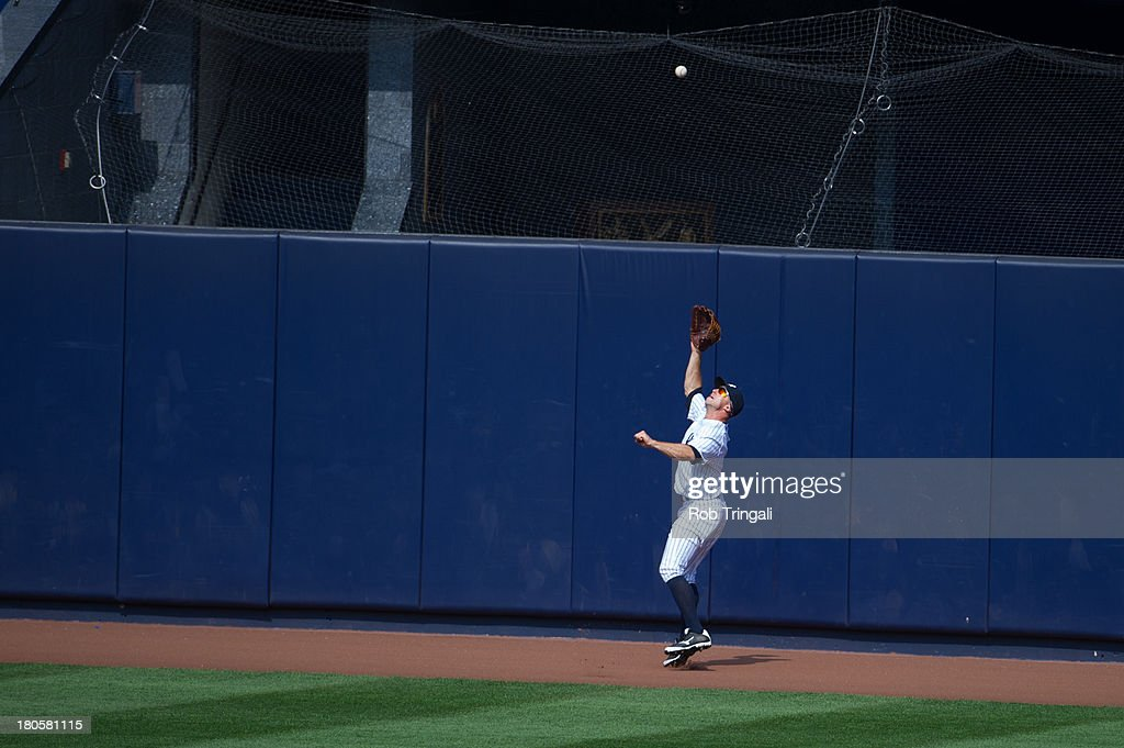 Brett Gardner #11 of the New York Yankees makes a diving catch into the wall during the game against the Detroit Tigers at Yankee Stadium on August 11, 2013 in the Bronx borough of Manhattan.