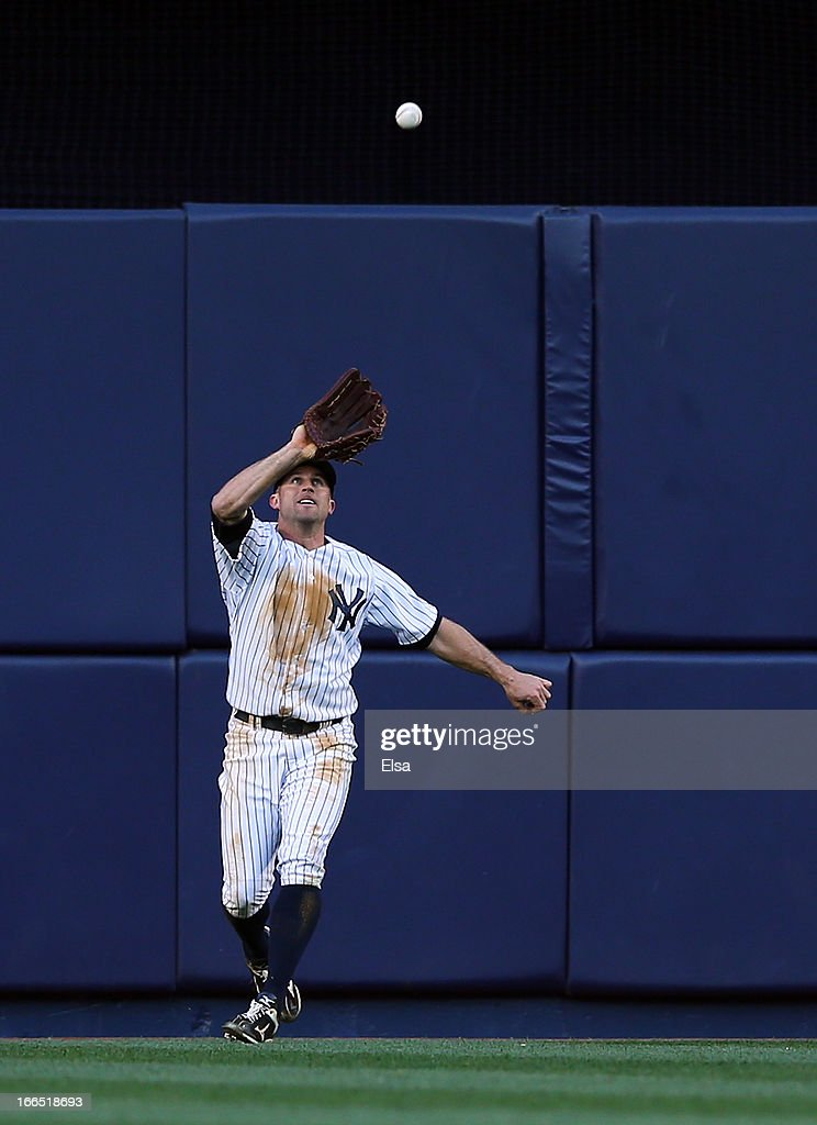 <a gi-track='captionPersonalityLinkClicked' href=/galleries/search?phrase=Brett+Gardner&family=editorial&specificpeople=4172518 ng-click='$event.stopPropagation()'>Brett Gardner</a> #11 of the New York Yankees makes the catch for the out in the ninth inning against the Baltimore Orioles on April 13, 2013 at Yankee Stadium in the Bronx borough of New York City.The Baltimore Orioles defeated the New York Yankees 5-3.