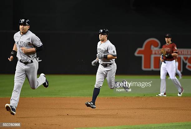Brett Gardner of the New York Yankees rounds the bases just behind teammate Jacoby Ellsbury after hitting a tworun home run off of Shelby Miller of...
