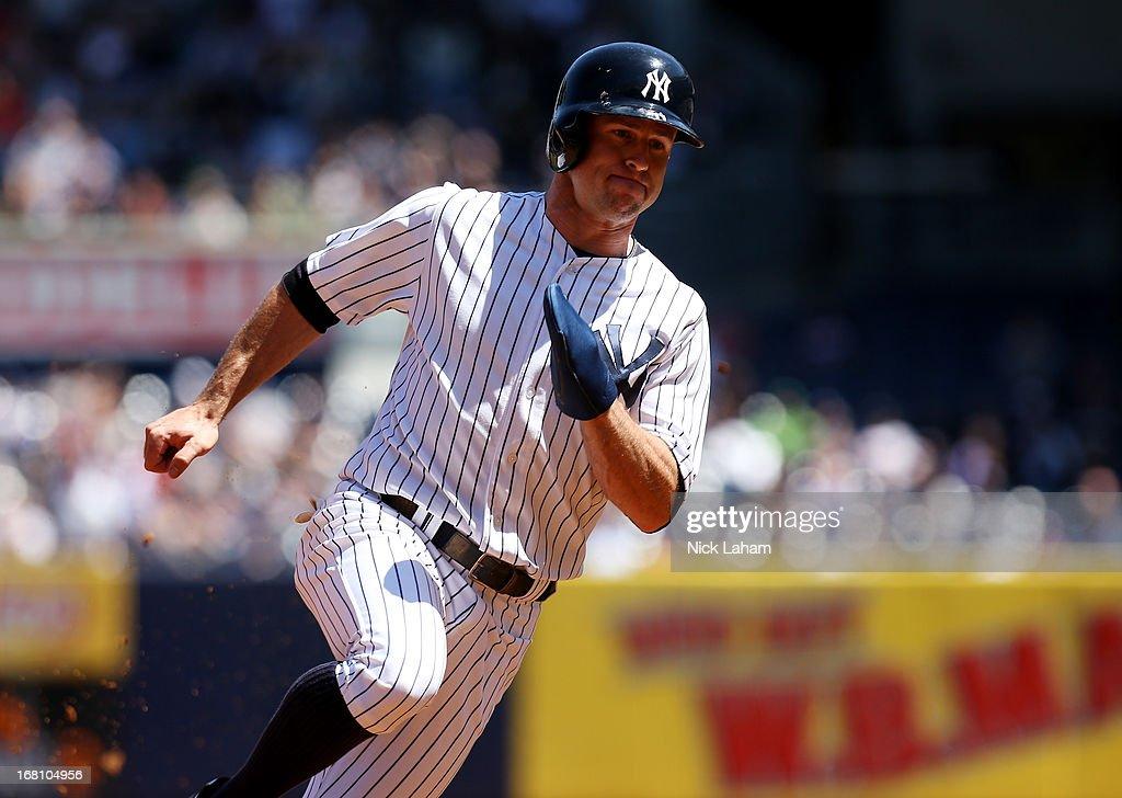 Brett Gardner #11 of the New York Yankees runs the bases against the Oakland Athletics at Yankee Stadium on May 5, 2013 in the Bronx borough of New York City.