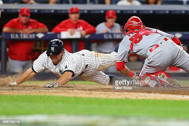 Brett Gardner of the New York Yankees scores ahead of the tag by Carlos Perez of the Los Angeles Angels on Alex Rodriguez RBI single in the seventh...