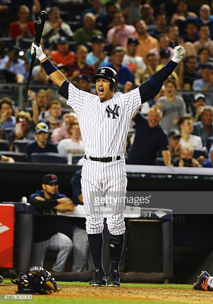 Brett Gardner of the New York Yankees scores on a wild pitch by Justin Verlander of the Detroit Tigers and Alex Rodriguez of the New York Yankees...