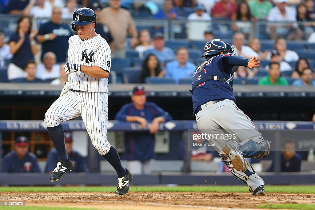 <a gi-track='captionPersonalityLinkClicked' href=/galleries/search?phrase=Brett+Gardner&family=editorial&specificpeople=4172518 ng-click='$event.stopPropagation()'>Brett Gardner</a> #11 of the New York Yankees scores on <a gi-track='captionPersonalityLinkClicked' href=/galleries/search?phrase=Carlos+Beltran&family=editorial&specificpeople=167108 ng-click='$event.stopPropagation()'>Carlos Beltran</a> #36 RBI double to left in the third inning against the Minnesota Twins at Yankee Stadium on June 24, 2016 in the Bronx borough of New York City. Boston