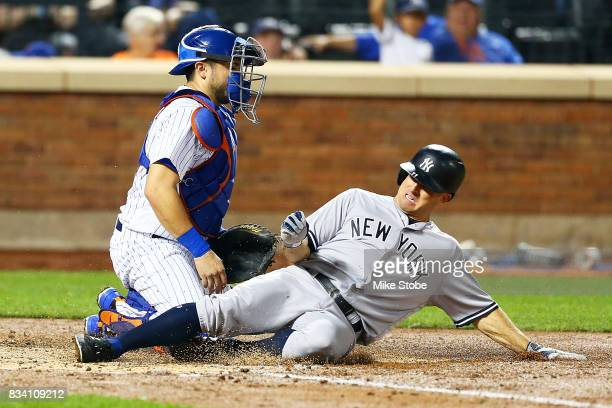 Brett Gardner of the New York Yankees scores on Gary Sanchez RBI single in the fourth inning in front of Travis d'Arnaud of the New York Mets at Citi...