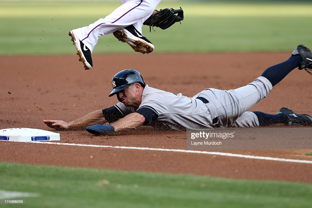 <a gi-track='captionPersonalityLinkClicked' href=/galleries/search?phrase=Brett+Gardner&family=editorial&specificpeople=4172518 ng-click='$event.stopPropagation()'>Brett Gardner</a> #11 of the New York Yankees slides safely into 3rd base under <a gi-track='captionPersonalityLinkClicked' href=/galleries/search?phrase=Adrian+Beltre&family=editorial&specificpeople=202631 ng-click='$event.stopPropagation()'>Adrian Beltre</a> #29 of the Texas Rangers on July 24, 2013 at the Rangers Ballpark in Arlington in Arlington, Texas.