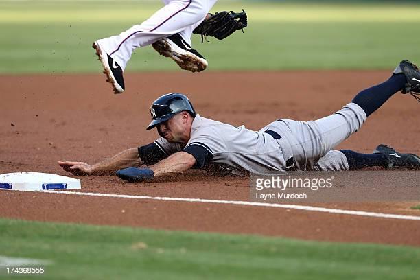 Brett Gardner of the New York Yankees slides safely into 3rd base under Adrian Beltre of the Texas Rangers on July 24 2013 at the Rangers Ballpark in...