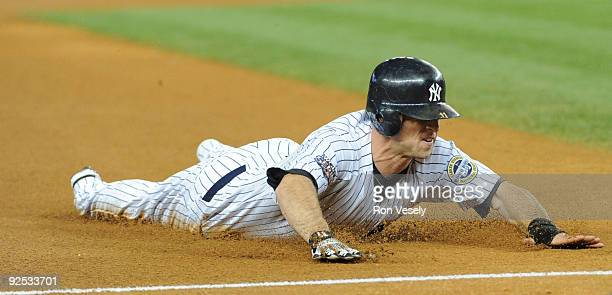 Brett Gardner of the New York Yankees slides to third base in the bottom of the seventh inning during game two of the 2009 World Series between the...