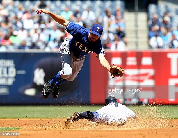 Brett Gardner of the New York Yankees steals second as Adam Rosales of the Texas Rangers defends in the first inning on May 23 2015 at Yankee Stadium...