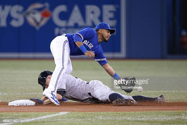 Brett Gardner of the New York Yankees steals second base in the first inning during MLB game action as Maicer Izturis of the Toronto Blue Jays cannot...