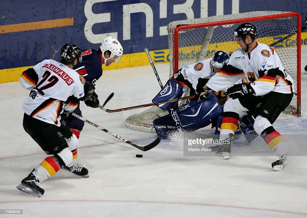 Brett Hammond tries to score the 4th goal for his team during the German Nations Cup match between Germany and USA at the TUI Arena on November 8...