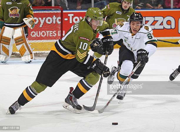 Brett Hargrave of the North Bay Battalion skates away from a checking Kole Sherwood of the London Knights during an OHL game at Budweiser Gardens on...