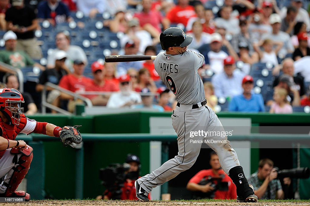 <a gi-track='captionPersonalityLinkClicked' href=/galleries/search?phrase=Brett+Hayes&family=editorial&specificpeople=795648 ng-click='$event.stopPropagation()'>Brett Hayes</a> #9 of the Miami Marlins hits an RBI single in the seventh inning against the Washington Nationals at Nationals Park on August 3, 2012 in Washington, DC.