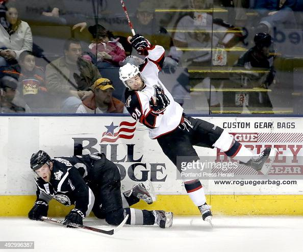 Brett Hextall of the Portland Pirates right checks Andrew Bodnarchuk of the Manchester Monarchs into the boards in the first period of the Portland...