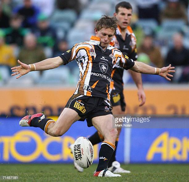 Brett Hodgson of the Tigers attempts a field goal in extra time during the round 19 NRL match between the Canberra Raiders and Wests Tigers played at...