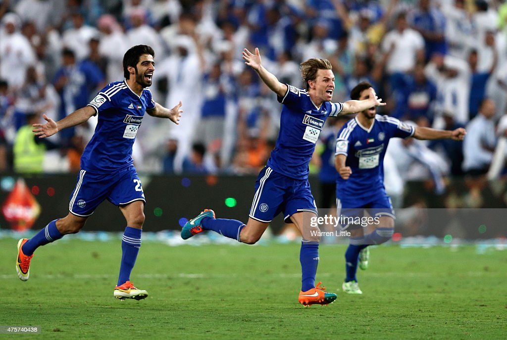 <a gi-track='captionPersonalityLinkClicked' href=/galleries/search?phrase=Brett+Holman&family=editorial&specificpeople=2224226 ng-click='$event.stopPropagation()'>Brett Holman</a>, Al Nasr Captain leads the celebrations after winning the penalty shoot out to win the President's Cup Final between Al Ahli and Al Nasr at Hazza bin Zayed Stadium on June 3, 2015 in Al Ain, United Arab Emirates.