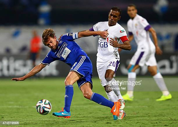 Brett Holman of Al Nasr competes for the ball with Helal Saeed of Al Ail during the Presidents Cup Quarter Final match between Al Ain and Al Nasr at...