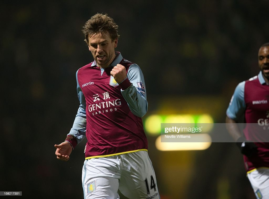 <a gi-track='captionPersonalityLinkClicked' href=/galleries/search?phrase=Brett+Holman&family=editorial&specificpeople=2224226 ng-click='$event.stopPropagation()'>Brett Holman</a> of Aston Villa celebrates his goal during the Capital One Cup Quarter Final match between Norwich City and Aston Villa at Carrow Road on December 11, 2012 in Norwich, England.