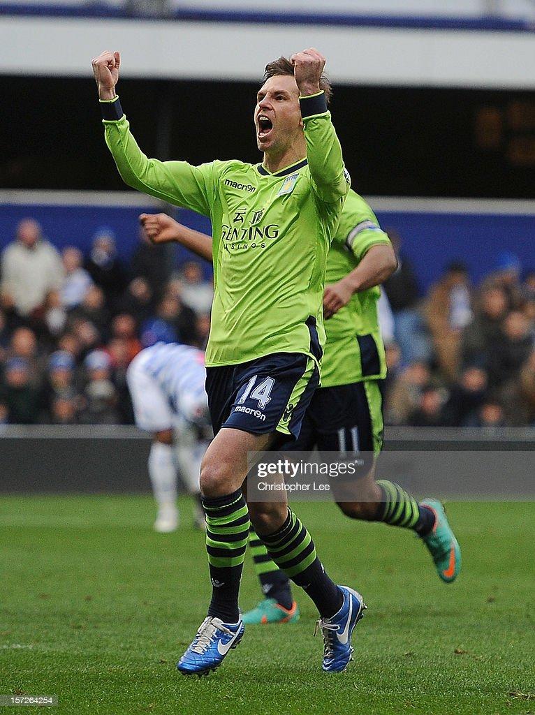 Brett Holman of Aston Villa celebrates scoring the opening goal during the Barclays Premier League match between Queens Park Rangers and Aston Villa...