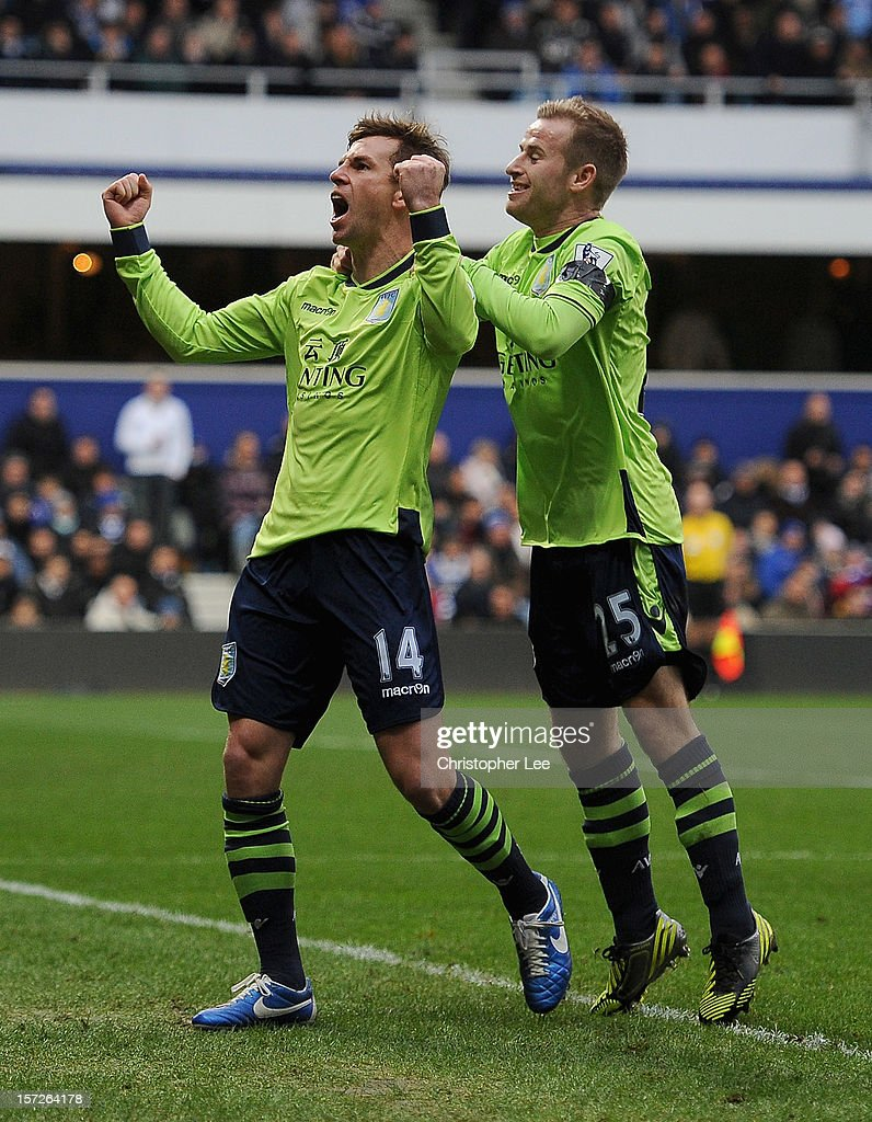 Brett Holman of Aston Villa celebrates scoring the opening goal with team mate Barry Bannan during the Barclays Premier League match between Queens...