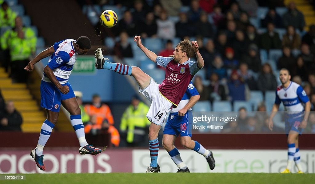 <a gi-track='captionPersonalityLinkClicked' href=/galleries/search?phrase=Brett+Holman&family=editorial&specificpeople=2224226 ng-click='$event.stopPropagation()'>Brett Holman</a> of Aston Villa challenged by <a gi-track='captionPersonalityLinkClicked' href=/galleries/search?phrase=Mikele+Leigertwood&family=editorial&specificpeople=224769 ng-click='$event.stopPropagation()'>Mikele Leigertwood</a> of Reading during the Barclays Premier League match between Aston Villa and Reading at Villa Park on November 27, 2012 in Birmingham, England.