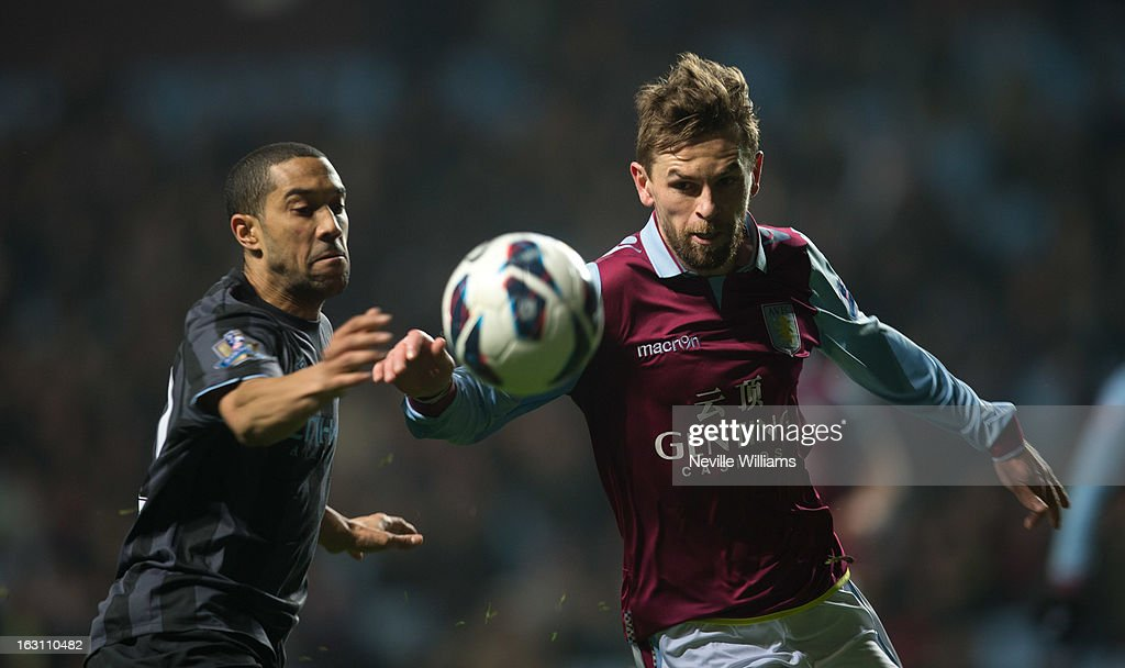 <a gi-track='captionPersonalityLinkClicked' href=/galleries/search?phrase=Brett+Holman&family=editorial&specificpeople=2224226 ng-click='$event.stopPropagation()'>Brett Holman</a> of Aston Villa is challenged by <a gi-track='captionPersonalityLinkClicked' href=/galleries/search?phrase=Gael+Clichy&family=editorial&specificpeople=214646 ng-click='$event.stopPropagation()'>Gael Clichy</a> of Manchester City during the Barclays Premier League match between Aston Villa and Manchester City at Villa Park on March 04, 2013 in Birmingham, England.