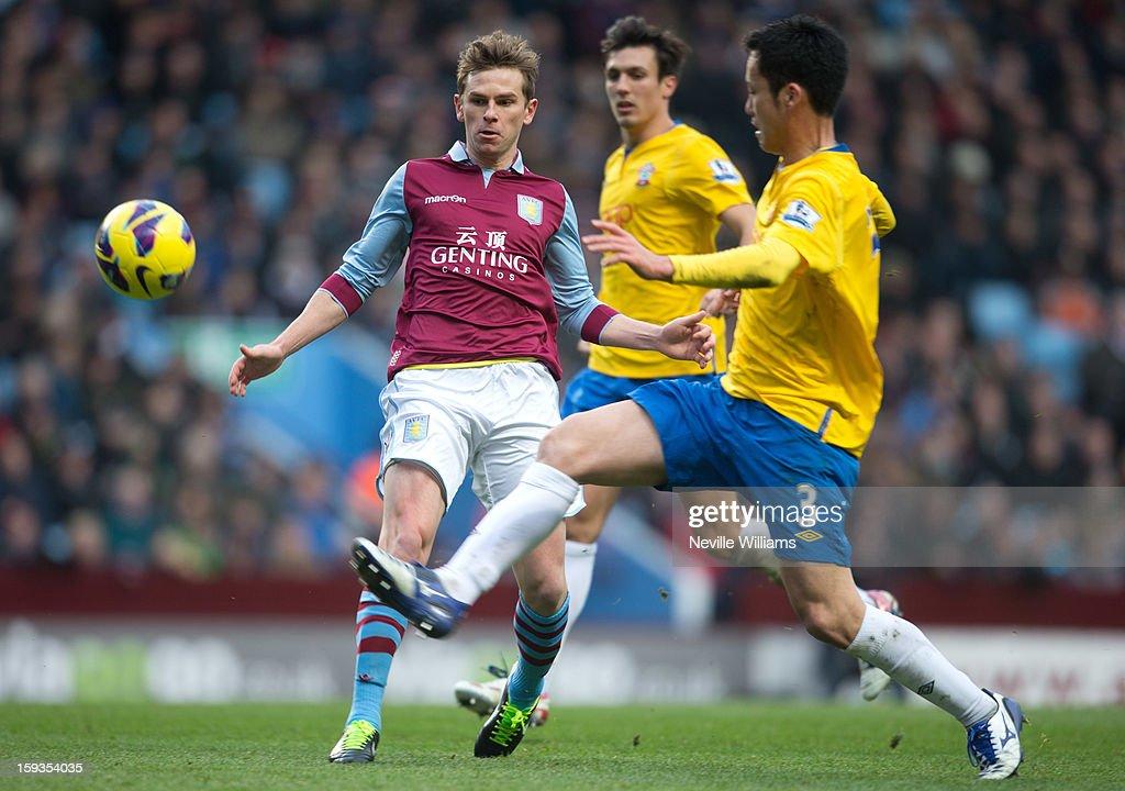 Brett Holman of Aston Villa is challenged by Maya Yoshida of Southampton during the Barclays Premier League match between Aston Villa and Southampton at Villa Park on January 12, 2013 in Birmingham, England.