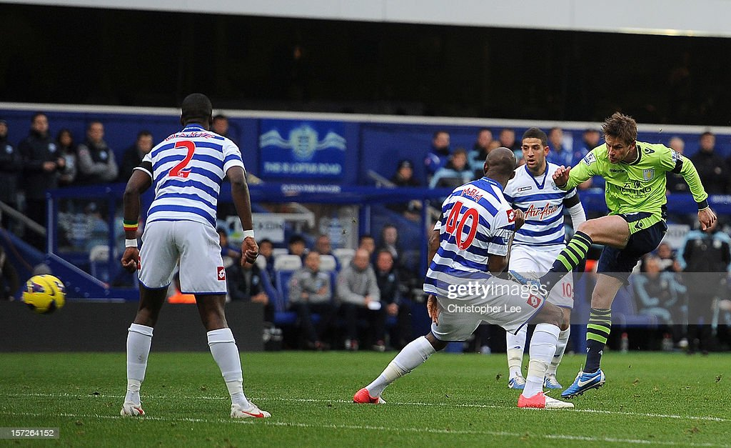 Brett Holman of Aston Villa scores the opening goal during the Barclays Premier League match between Queens Park Rangers and Aston Villa at Loftus...