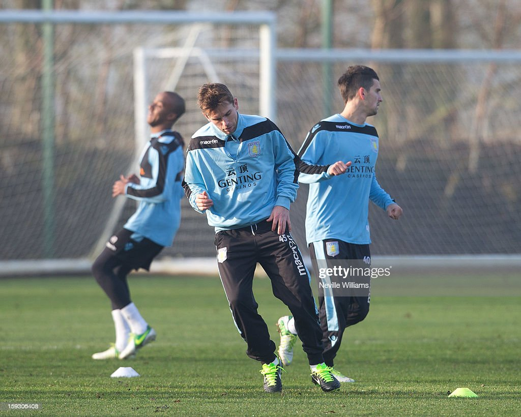 <a gi-track='captionPersonalityLinkClicked' href=/galleries/search?phrase=Brett+Holman&family=editorial&specificpeople=2224226 ng-click='$event.stopPropagation()'>Brett Holman</a> of Aston Villa trains with team mates during a Aston Villa training session at the club's training ground at Bodymoor Heath on January 11, 2013 in Birmingham, England.