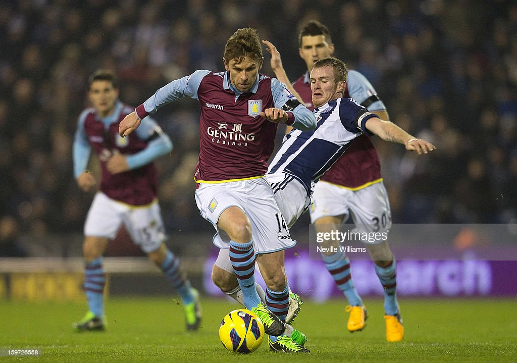<a gi-track='captionPersonalityLinkClicked' href=/galleries/search?phrase=Brett+Holman&family=editorial&specificpeople=2224226 ng-click='$event.stopPropagation()'>Brett Holman</a> (L) of Aston Villa vies with <a gi-track='captionPersonalityLinkClicked' href=/galleries/search?phrase=Chris+Brunt&family=editorial&specificpeople=809047 ng-click='$event.stopPropagation()'>Chris Brunt</a> (R) of West Bromwich Albion during the Barclays Premier League match between West Bromwich Albion and Aston Villa at The Hawthorns on January 19, 2013 in West Bromwich England.