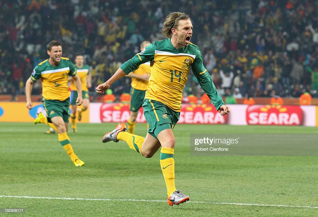 Brett Holman of Australia celebrates scoring his side's second goal during the 2010 FIFA World Cup South Africa Group D match between Australia and...