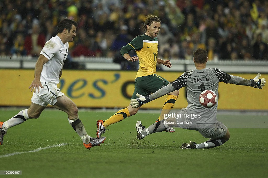 Brett Holman of Australia gets the ball past New Zealand goalkeeper Mark Paston to score during the 2010 FIFA World Cup Pre-Tournament match between the Australian Socceroos and the New Zealand All Whites at Melbourne Cricket Ground on May 24, 2010 in Melbourne, Australia.