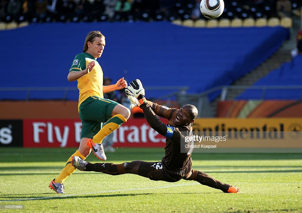 <a gi-track='captionPersonalityLinkClicked' href=/galleries/search?phrase=Brett+Holman&family=editorial&specificpeople=2224226 ng-click='$event.stopPropagation()'>Brett Holman</a> of Australia lifts the ball over <a gi-track='captionPersonalityLinkClicked' href=/galleries/search?phrase=Richard+Kingson&family=editorial&specificpeople=537332 ng-click='$event.stopPropagation()'>Richard Kingson</a> of Ghana and scores the opening goal during the 2010 FIFA World Cup South Africa Group D match between Ghana and Australia at the Royal Bafokeng Stadium on June 19, 2010 in Rustenburg, South Africa.