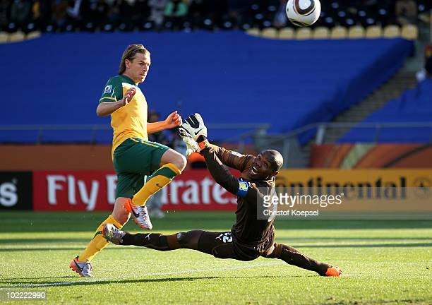 Brett Holman of Australia lifts the ball over Richard Kingson of Ghana and scores the opening goal during the 2010 FIFA World Cup South Africa Group...