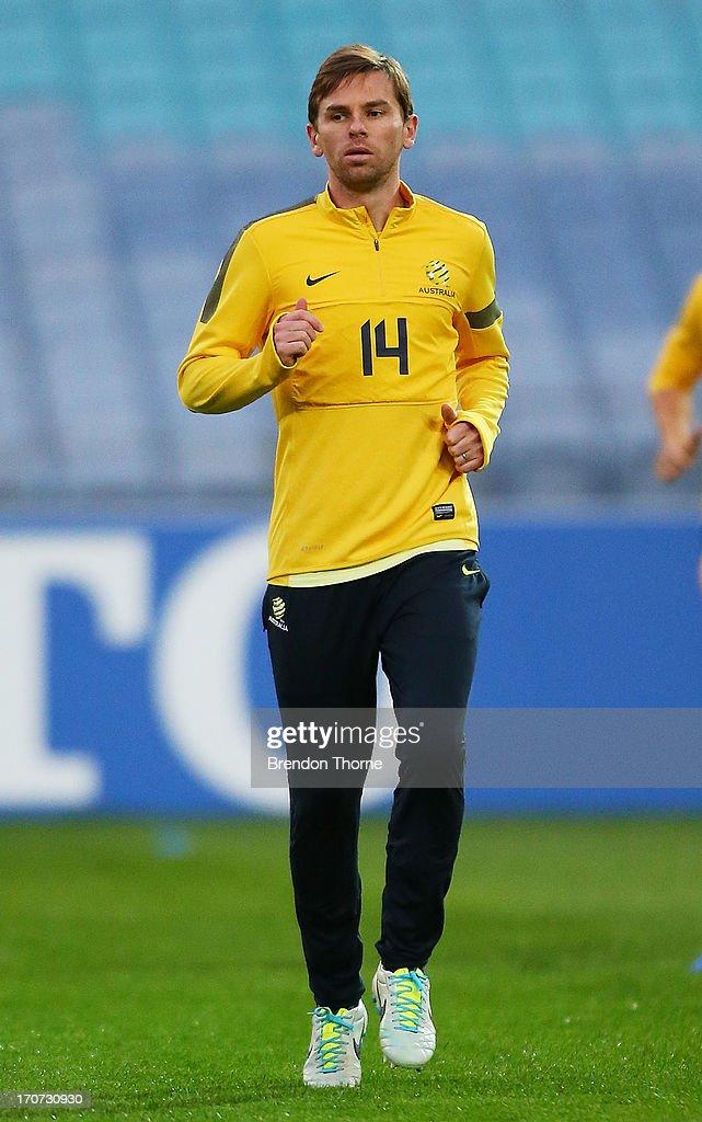 Brett Holman of Australia warms up during an Australian Socceroos training session at ANZ Stadium on June 17 2013 in Sydney Australia