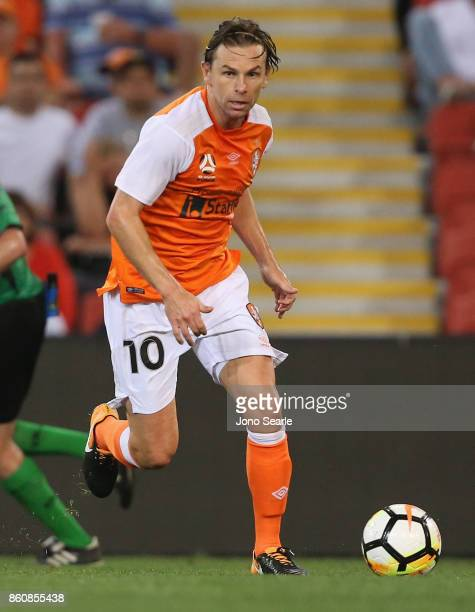 Brett Holman of Brisbane runs with the ball during the round two ALeague match between the Brisbane Roar and Adelaide United at Suncorp Stadium on...
