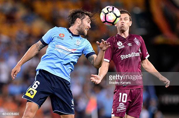 Brett Holman of the Roar and Joshua Brillante of Sydney compete for the ball during the round seven ALeague match between the Brisbane Roar and...