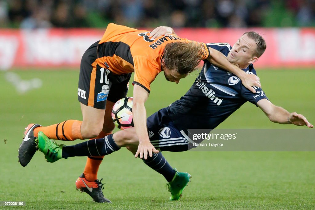 Brett Holman of the Roar and Leigh Broxham of the Victory compete for the ball during the A-League Semi Final match between Melbourne Victory and the Brisbane Roar at AAMI Park on April 30, 2017 in Melbourne, Australia.