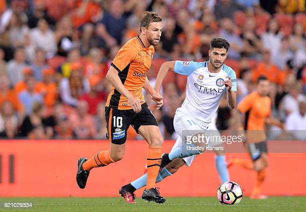 Brett Holman of the Roar breaks away from the defence during the round five ALeague match between the Brisbane Roar and Melbourne City FC at Suncorp...