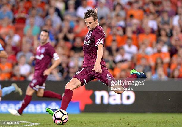Brett Holman of the Roar has a shot at goal during the round seven ALeague match between the Brisbane Roar and Sydney FC at Suncorp Stadium on...