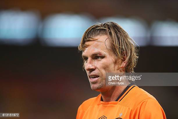 Brett Holman of the Roar looks on during the round one ALeague match between the Brisbane Roar and Melbourne Victory at Suncorp Stadium on October 7...