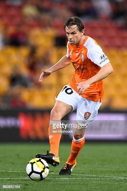 Brett Holman of the Roar passes the ball during the round two ALeague match between the Brisbane Roar and Adelaide United at Suncorp Stadium on...