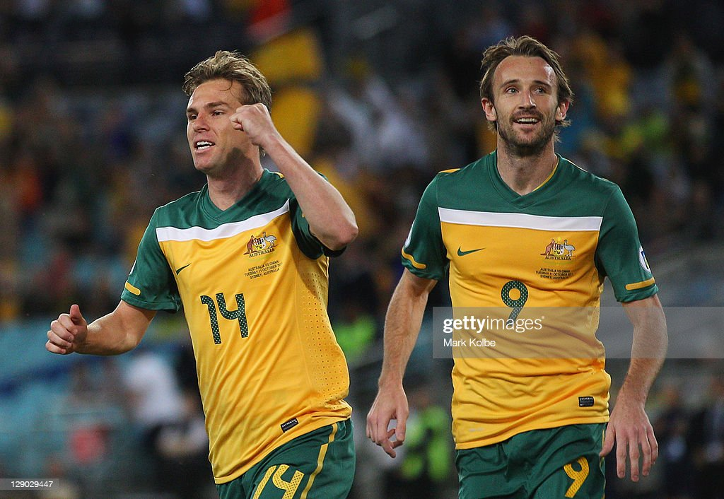 Brett Holman of the Socceroos celebrates after scoring a goal during the FIFA World Cup Asian Qualifier match between the Australian Socceroos and...