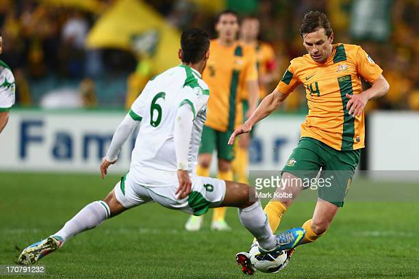 Brett Holman of the Socceroos runs the ball during the FIFA 2014 World Cup Asian Qualifier match between the Australian Socceroos and Iraq at ANZ...